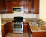 pre-fab-maple-cabinets-granite-countertops-new-electrical-outlets-under-mount-sink