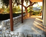 concrete-patio-with-river-rock-veener_after